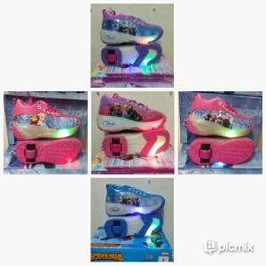 Merk Disney bisa Sepatu bisa SEPATU 1 RODA, Ada Lampu .Gambar frozen Pink dan Biru no 28-36 Rp 250.000